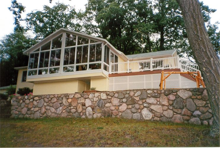All-Glass Gable Style Sunroom with Stone Foundation in Northern Michigan