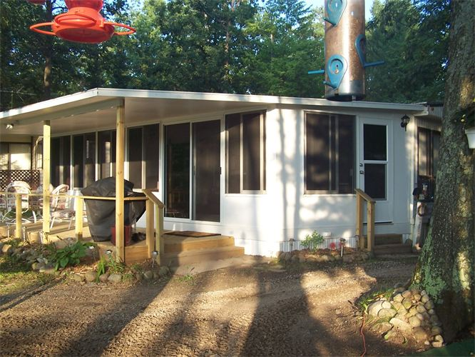 Covered Deck Studio Style Sunroom in Northern Michigan