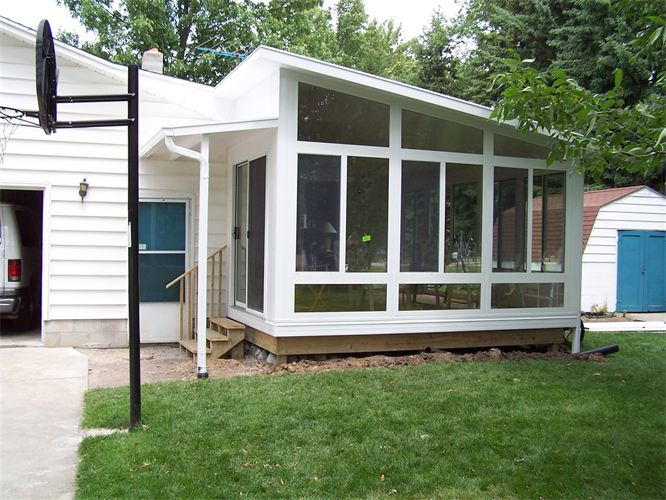 Exagerrated Wedge Studio Style Sunroom in Northern Michigan