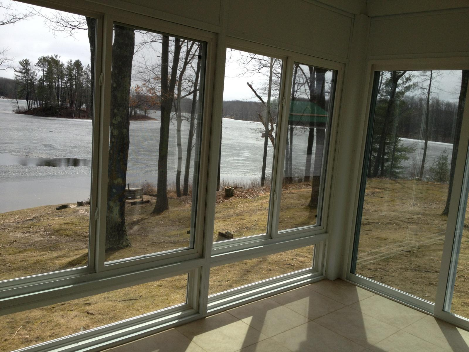 View from Interior Wall System Style Sunroom in Northern Michigan